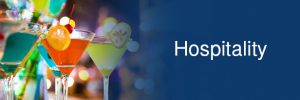 Hospitality - martini glasses with colorful drinks and garnishes